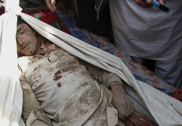 A young man reportedly killed in the airstrike. The authenticity of the images is under question. Afghanistan Presidential Palace, via Associated Press