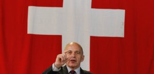 Swiss Defence Minister Maurer gestures during a news conference at the Swiss Army Electronic War Fare education commando Base in Jassbach