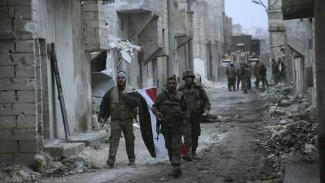 reuters. Syrische soldaten die vechten voor president Bashar Assad.