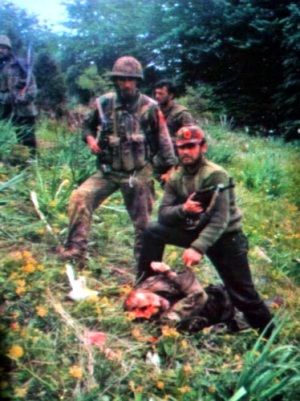 The Albanian terrorists posing with a massacred Serb