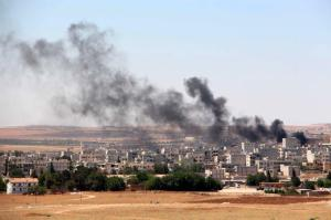 A picture taken from the Turkish side of the border shows smoke rising after renewed attack by Islamic State in Kobane, Syria, June 25, 2015. (Photo via EPA)